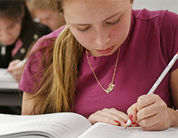 female student taking college board tests
