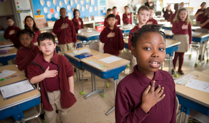 Charter school classroom students saying the pledge of allegiance